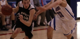 Sports:  Boys basketball on top in league, second at tournament