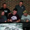 Sports: Two seniors sign to play football in college